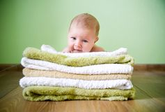 Newborn baby on a towels Stock Image