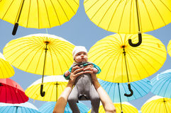 Newborn baby under a colorful umbrellas. Royalty Free Stock Photo