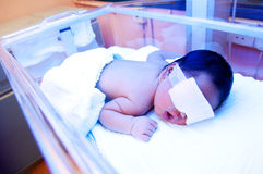 Newborn Baby Under Ultraviolet Light Royalty Free Stock Photo