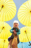 Newborn baby under a yellow umbrellas. Royalty Free Stock Images