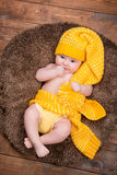 Newborn baby in a warm knitted hat. stock image