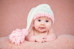 Newborn baby in a warm knitted hat. Royalty Free Stock Photo