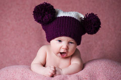 Newborn baby in a warm knitted hat. Stock Photos