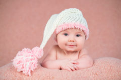 Newborn baby in a warm knitted hat. Royalty Free Stock Photos