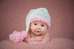 Newborn baby in a warm knitted hat. Stock Photography