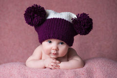 Newborn baby in a warm knitted hat. Royalty Free Stock Photography
