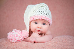 Newborn baby in a warm knitted hat. Royalty Free Stock Image