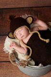 Newborn Baby Wearing a Monkey Hat Stock Photography