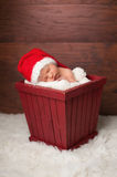 Newborn Baby Wearing a Santa Hat Stock Image