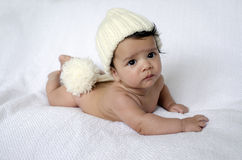 Newborn baby wearing a white hat Stock Photography
