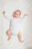 Newborn baby in white romper Royalty Free Stock Image