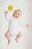Newborn baby in white romper Stock Photo