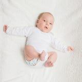 Newborn baby in white romper Royalty Free Stock Photo