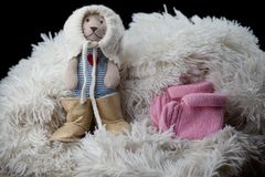 Newborn baby wool clothes shoes toy bear. Studio stock photography