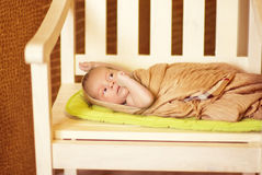Newborn baby Wrapped in brown blanket Royalty Free Stock Photos