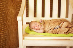 Newborn baby Wrapped in brown blanket Stock Image