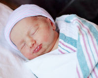 Newborn baby wrapped up in a blanket royalty free stock images