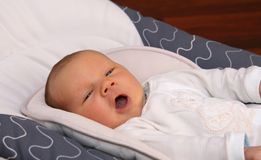 Newborn baby yawning Royalty Free Stock Images