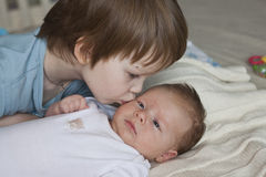 Newborn baby and 5 years old brother Stock Photography
