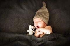 Newborn babysleeping with a toy royalty free stock photos