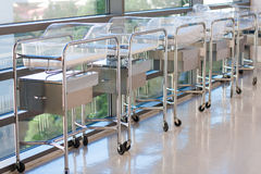Newborn bassinets or beds in hospital hallway Royalty Free Stock Photos