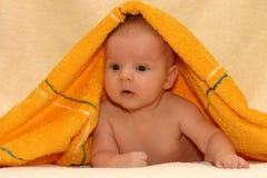 Newborn after bath. Under towel Stock Photos