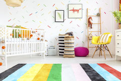 Newborn bedroom with yellow chair Stock Image