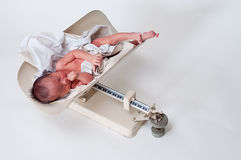 Newborn being weighed Stock Photo