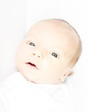 Newborn boy. New born boy in a high key focused on eyes nose and mouth Stock Photography