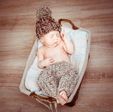 Newborn boy  asleep in the basket Royalty Free Stock Photography