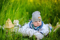 Newborn boy in the beautiful park royalty free stock photography