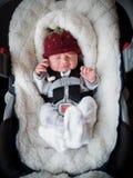 Newborn boy in car seat stock image