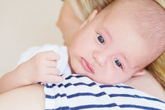 Newborn boy on the shoulder of mother Royalty Free Stock Photo