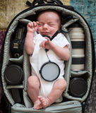 A newborn boy sleeping in bag stock images