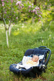 Newborn boy sleeping in car seat Royalty Free Stock Image