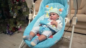 Boy swing in automatic electrical baby chair. Newborn boy swing in automatic electrical baby chair stock footage