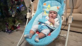 Newborn boy swing in electrical baby chair. Newborn boy swing in automatic electrical baby chair stock video footage