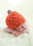 Newborn in a cap pumpkin Stock Photo