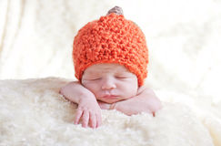 Newborn in a cap pumpkin Royalty Free Stock Photo