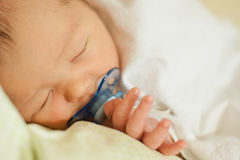 Newborn child on an extract from the maternity hospital stock photo
