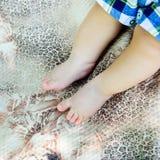 Newborn child feets Stock Photo