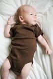Newborn child on green blanket. Stock Image