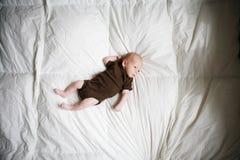 Newborn child on green blanket. Stock Images