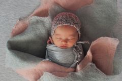 A newborn child in the image of a flower installation Stock Photo