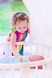 Newborn child meets his sister Stock Images