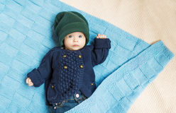 Newborn child relaxing in bed. Stock Images
