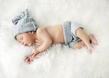 Newborn child sleeping on the blanket Royalty Free Stock Images