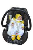 The newborn child sleeps in a children's car seat.  Royalty Free Stock Photography