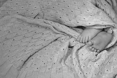 Newborn child small feet on blanket, cute toes closeup Royalty Free Stock Photos