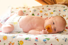 Newborn on the cover dresser Royalty Free Stock Photography